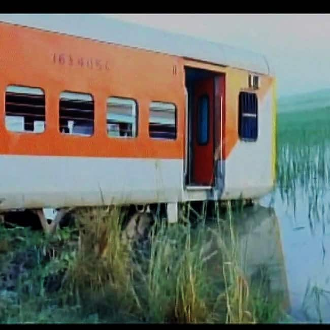 A coach of Kaifiyat express sunken in water near tracks