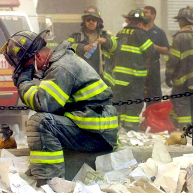 A Fire fighter breaks down after 9 11 attack