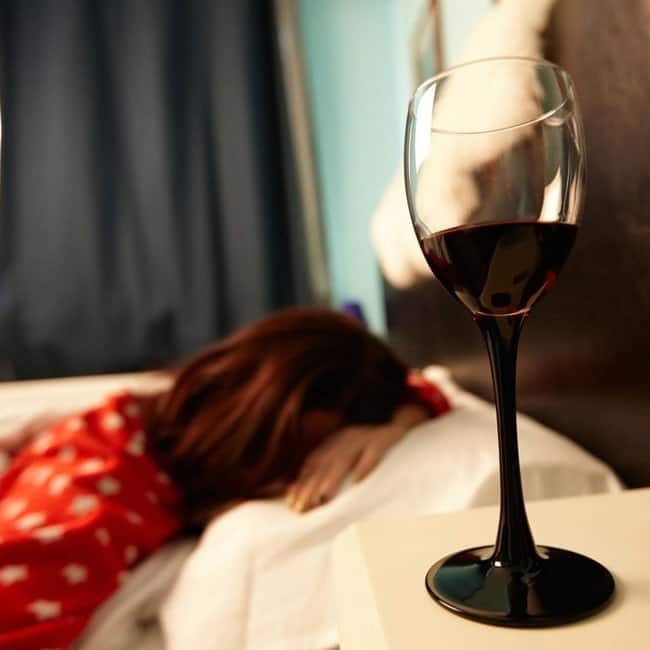 A glass of wine before bed will help you get a better night's rest