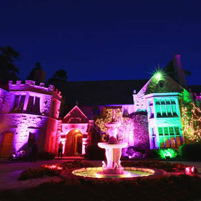 A outside view of Playboy Mansion at night