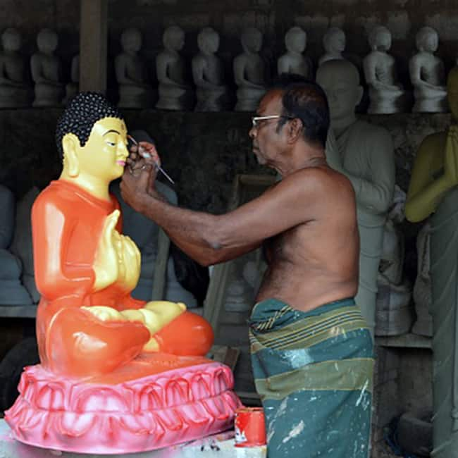 Artist carving out Lord Buddha   s statue