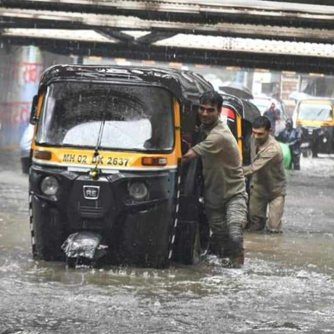 Autos crawling through flooded roads of Mumbai