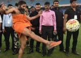 IN PICS: Baba Ramdev shows off his football skills during Football match in Delhi