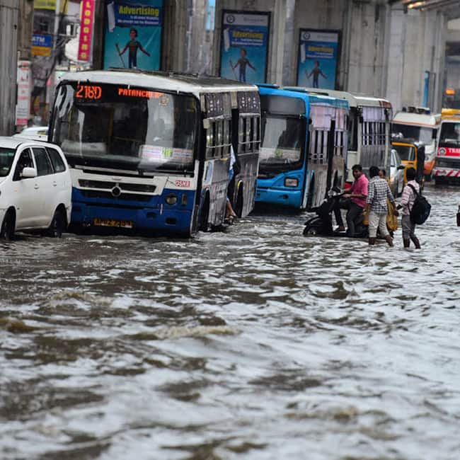 Buses crawling through flooded roads of Hyderabad