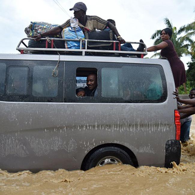 Citizens trying to cross river amid Hurricane Matthew