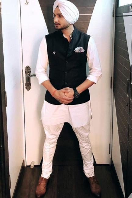 Cricketer Harbhajan Singh in Raghavendra Rathore
