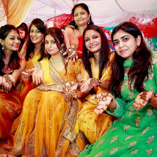 Mehndi And Haldi Ceremony : Divyanka tripathi poses for a photo during haldi ceremony