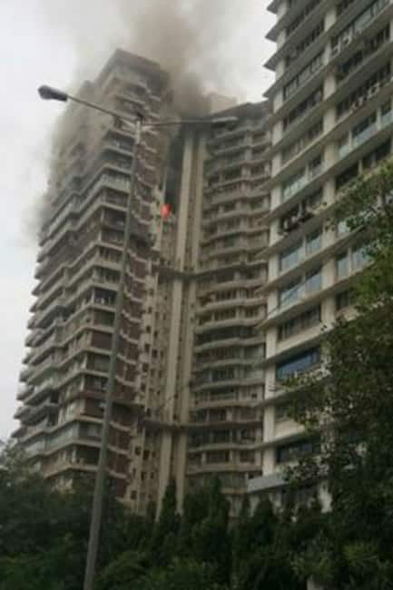 Rescuers moving towards cuffe parade 39 s maker chambers in for Jolly maker apartments cuffe parade