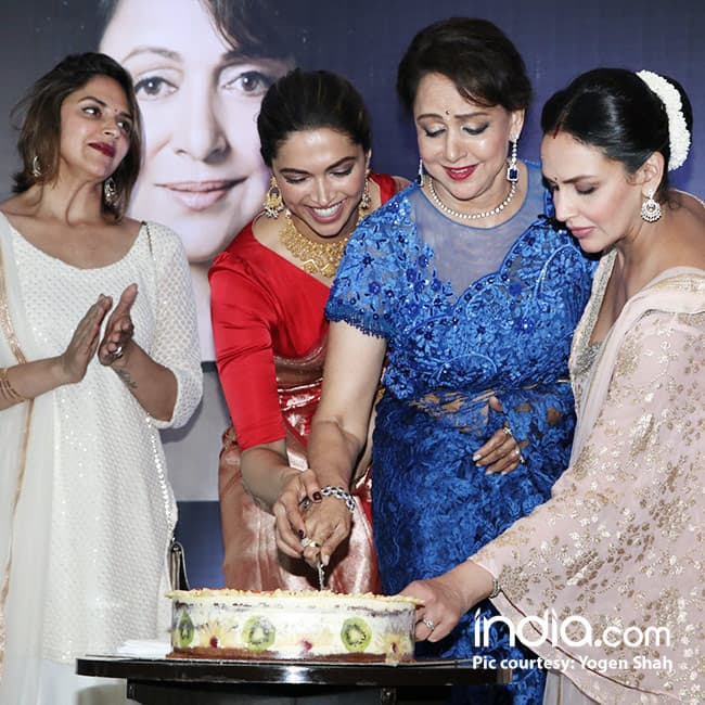 Hema Malini cutting her 69th birthday cake