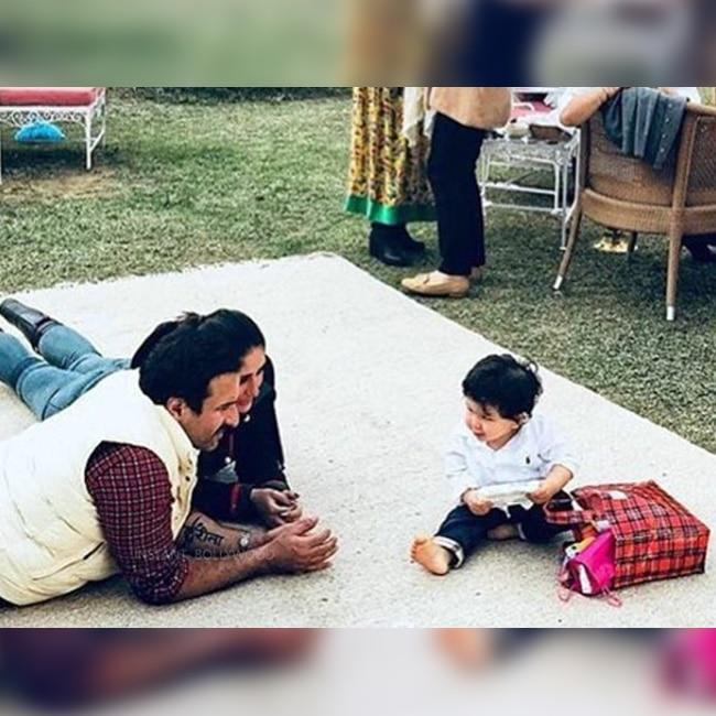 Kareena Kapoor Khan and Saif Ali Khan playing with Taimur