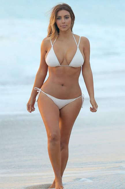 Kim Kardashian looks steamy in white bikini