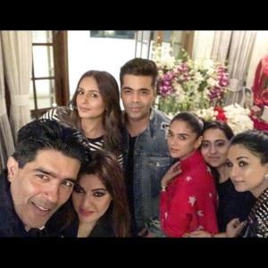Designer Manish Malhotra gets a filmy surprise by friends on his birthday