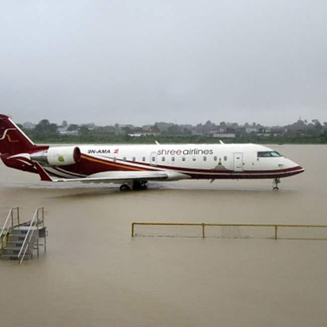 Plane makes landing in flood hot Nepal