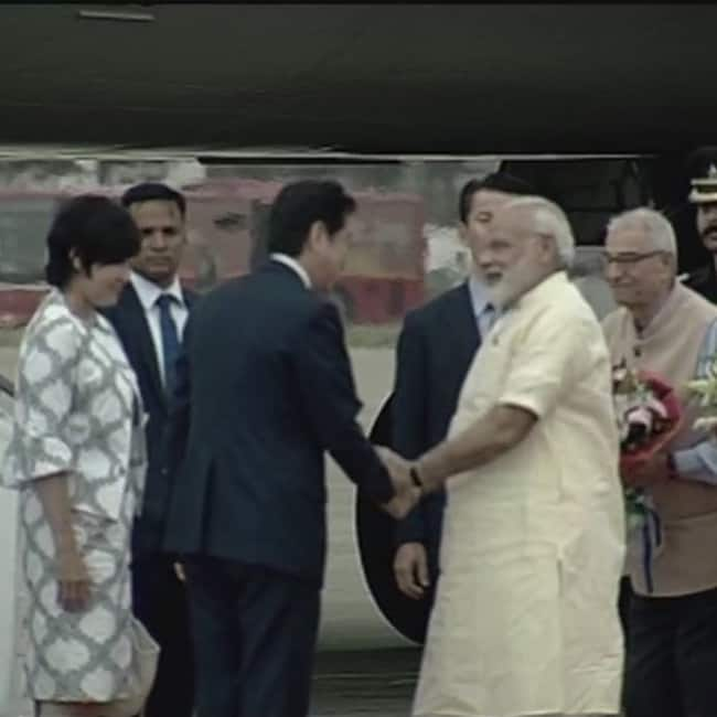 PM Narendra Modi receives Japanese Prime Minister Shinzo Abe at Ahmedabad airport