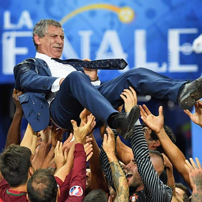 Portugal players celebrating with manager Fernando Santos after winning EURO 2016