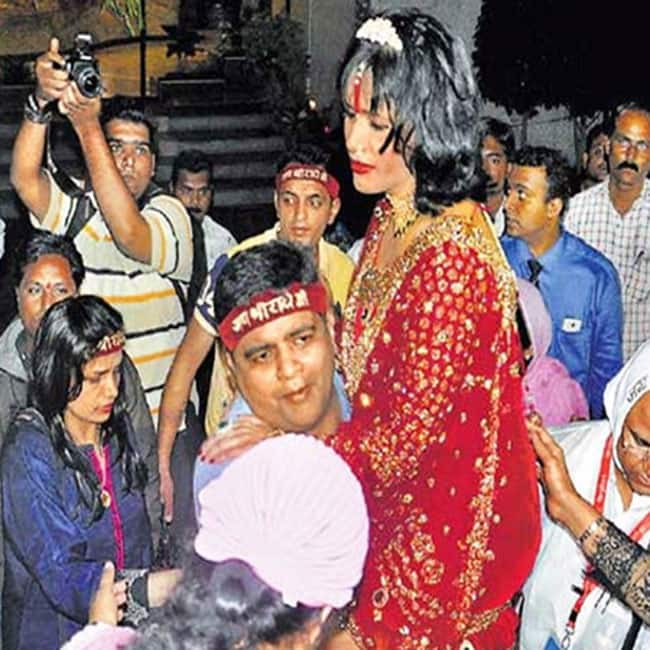 Radhe Maa in the arms of a devotee