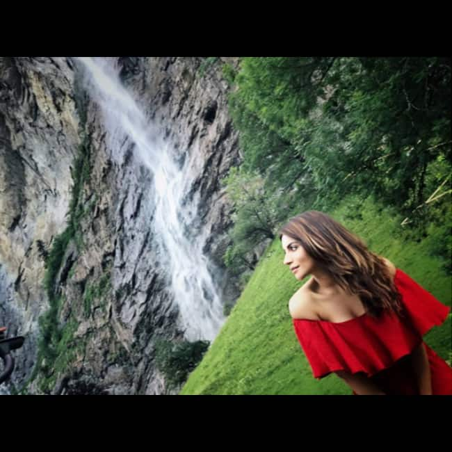 Shama Sikander with a waterfall in Switzerland