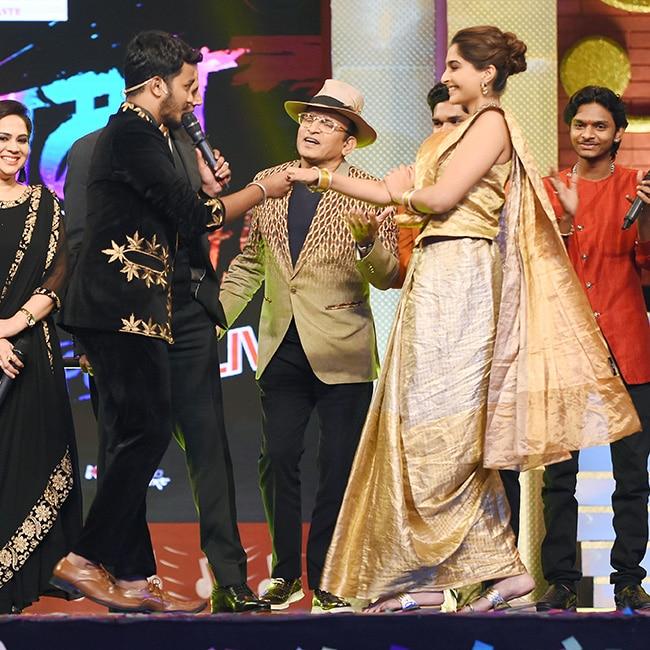 Sonam Kapoor dancing with a contestant at Sa Re Ga Ma Pa Marathi