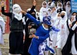 PICS: Kashmir violence; girls outrage anger by pelting stones at police forces!