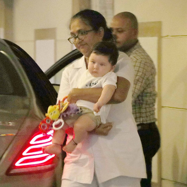 Taimur Ali Khan with his caretaker under his house