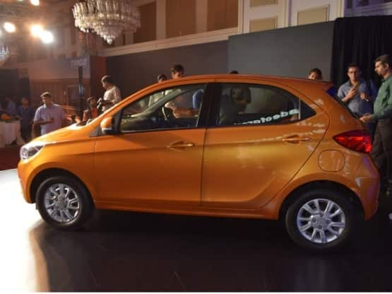 The side profile gets flared wheel arches while the car gets a purposeful character line that extends from the front wheels till the rear taillights  The Tiago also gets ORVM mounted turn indicators that add to the design of the car  The car rides on nicely designed 10 spoke 14 inch alloy wheels