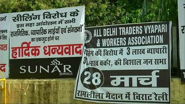 Traders hold protest at Ramlila Maidan today against sealing drive in Delhi