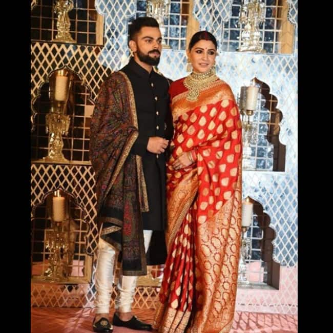 Virat Kohli -Anushka Sharma pose during their wedding reception in Delhi