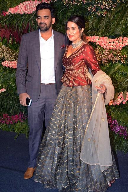Zaheer Khan with wife Sagarika Ghatge at Virushka   s wedding reception