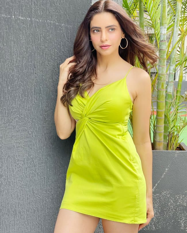 Aamna Sharif wore a front knot dress with a plunging neckline