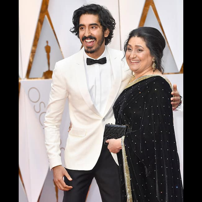 Actor Dev Patel with mother Anita Patel at red carpet of 89th Annual Academy awards