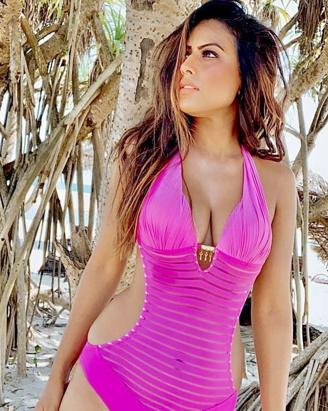 After a pink bikini  Nia Sharma poses in a fuschia coloured monokini