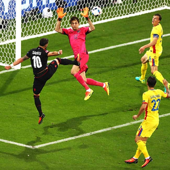 Albania   s Armando Sadiku  heads to score the first goal against Romania in UEFA EURO 2016