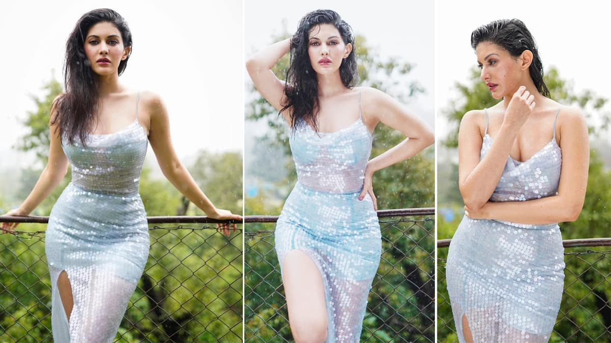 Amyra Dastur flaunts her sexiness while making the most of monsoons in this gorgeous silver dress