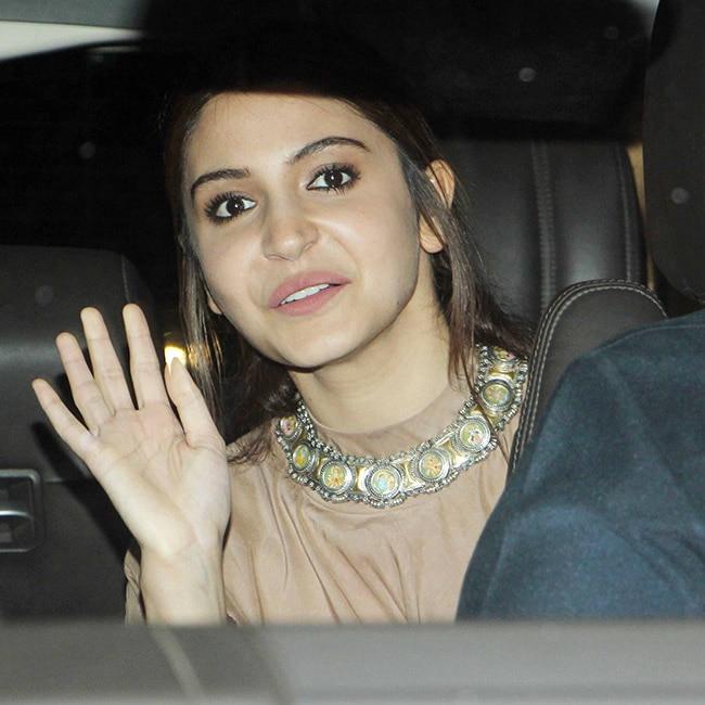 Anushka Sharma waves to cameras before Phillauri screening