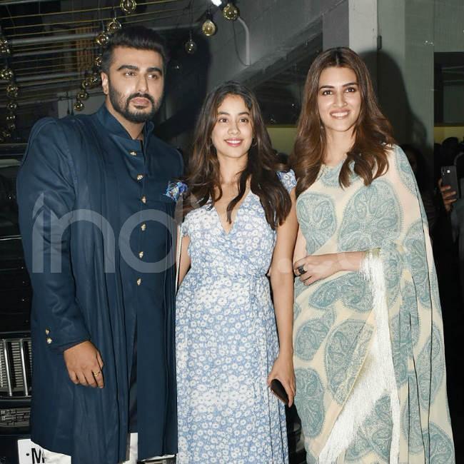 Arjun  Janhvi pose with Kriti Sanon at the screening