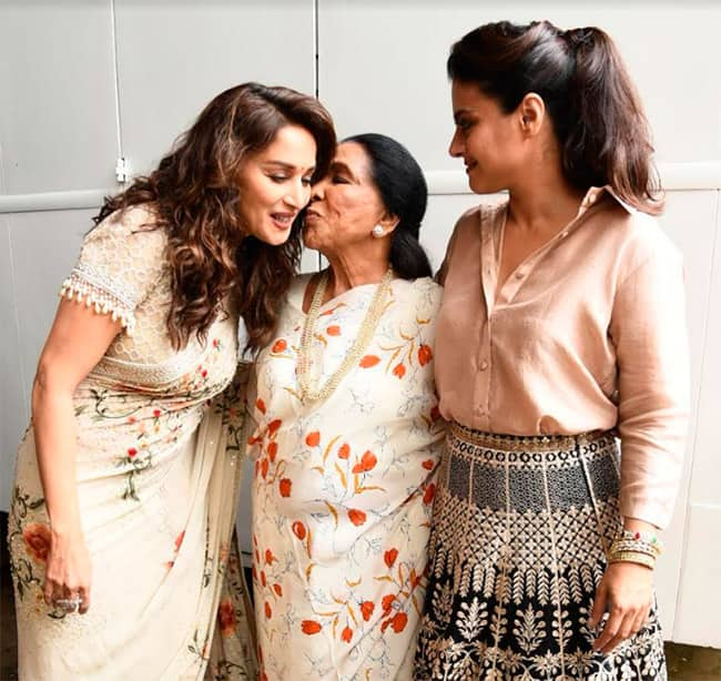 Asha Tai s gives a peck to Madhuri