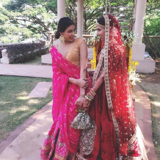 Athiya Shetty in a subtle pink and orange lehenaga at her friend   s wedding