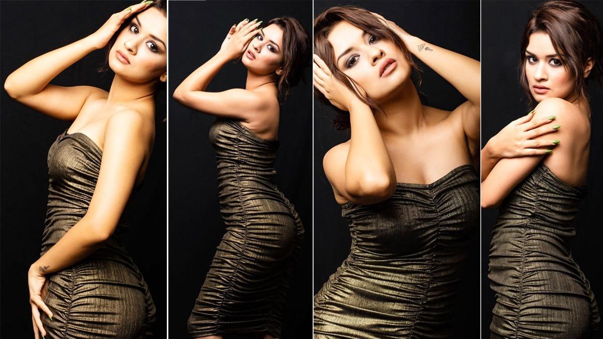 Avneet Kaur looks glamorous in a black charcoal dress