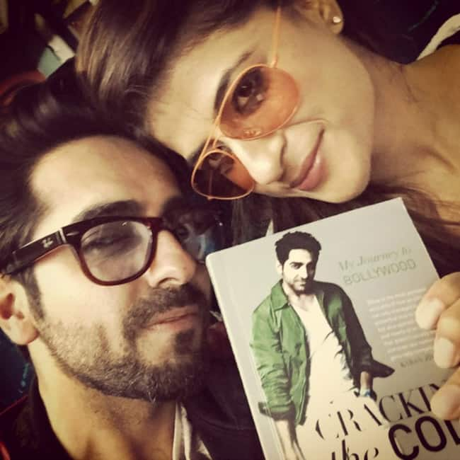 Ayushmann Khurrana unveiling his book Cracking the Code with wife Tahira Kashyap