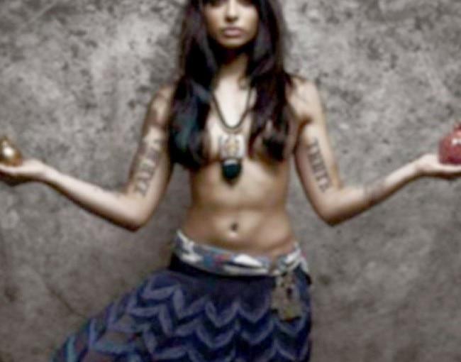 BB 10 contestant VJ Bani poses semi nude during a bold