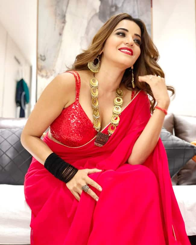 Bhojpuri siren Monalisa is ruling the internet with her smoky hot pics in red saree