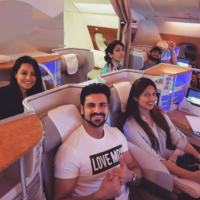 Celebs of Television pose for a picture in flight