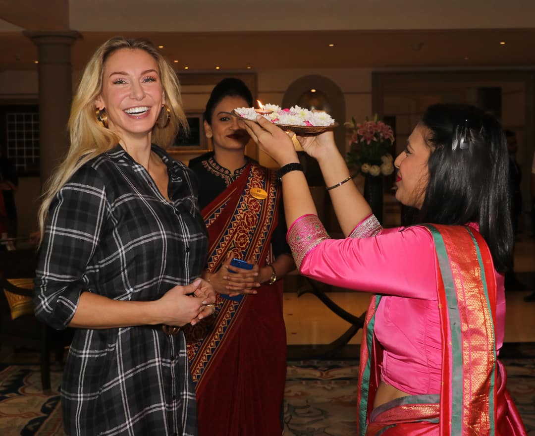 Charlotte Flair receives given the traditional Indian welcome