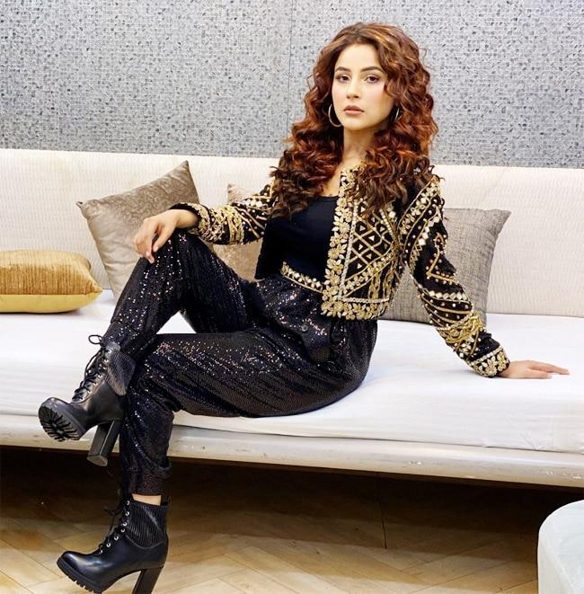 Check out Shehnaaz Gill photos in black and golden jacket