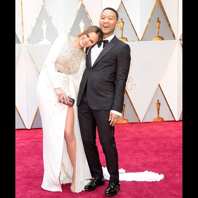 Chrissy Teigen with husband John Legend at red carpet of 89th Annual Academy awards