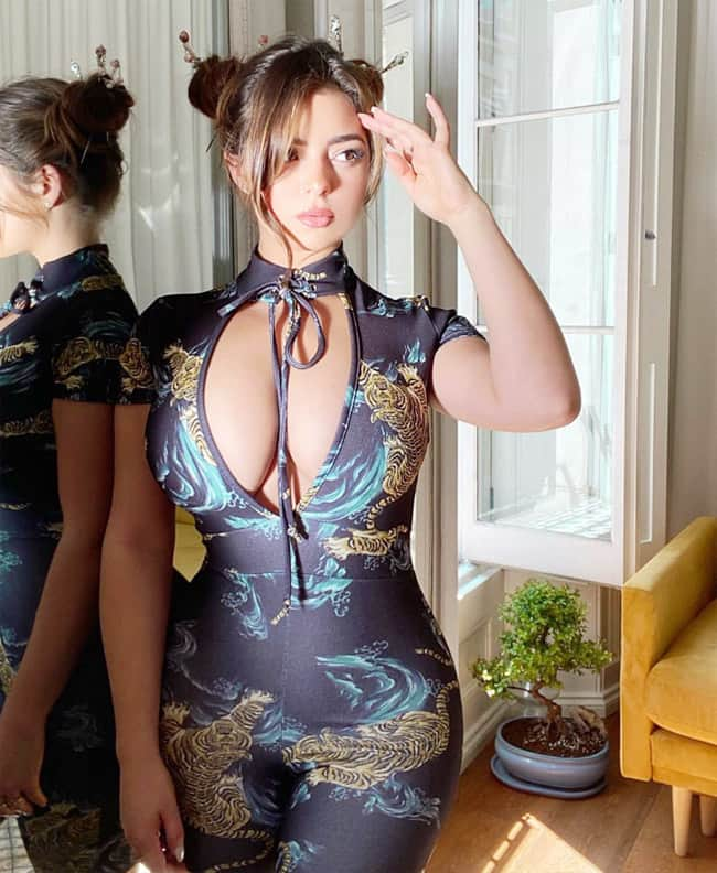 Demi Rose Wears Body touching Outfit With Deep Neckline