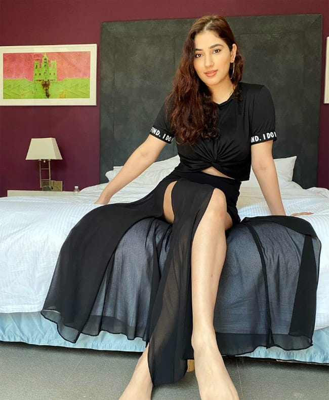 Disha Parmar all black featured a knotted crop top and sheer slit dress