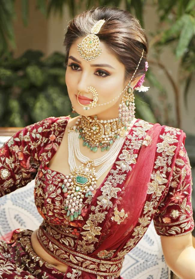 Donal Bisht Mesmerises as Bride in Heavily Embroidered Maroon Lehenga For Latest Photoshoot | See Pics