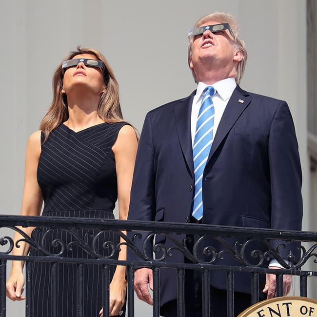 Donald Trump and Melina Trump gazing at the sky from the White House