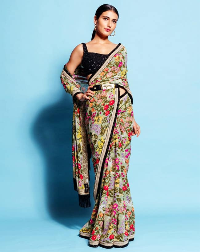 Fatima dolled up in this stunning saree  and she teamed it up with a sleeveless black sequin blouse
